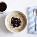 Creamy steel-cut oatmeal with blueberry-basil compote