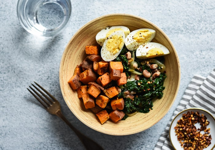 Warm Kale Salad with Rosemary Sweet Potatoes and Eggs