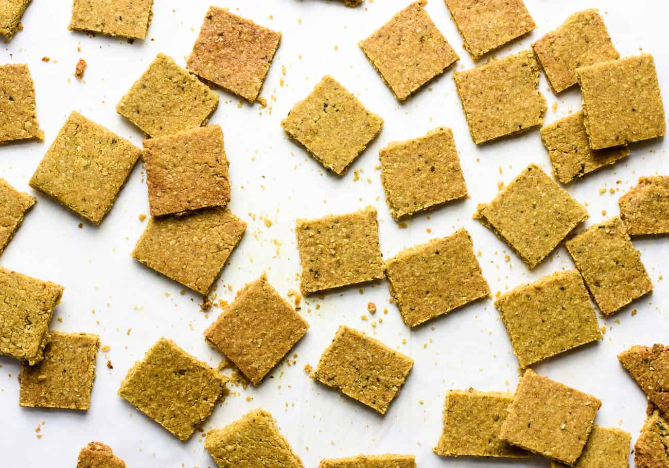 Close-up overhead image of homemade crackers made with nutritional yeast and turmeric