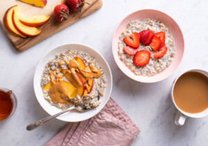 Basic overnight oats with chia seeds in a Mason jar, topped with peanut butter, bananas, and blueberries