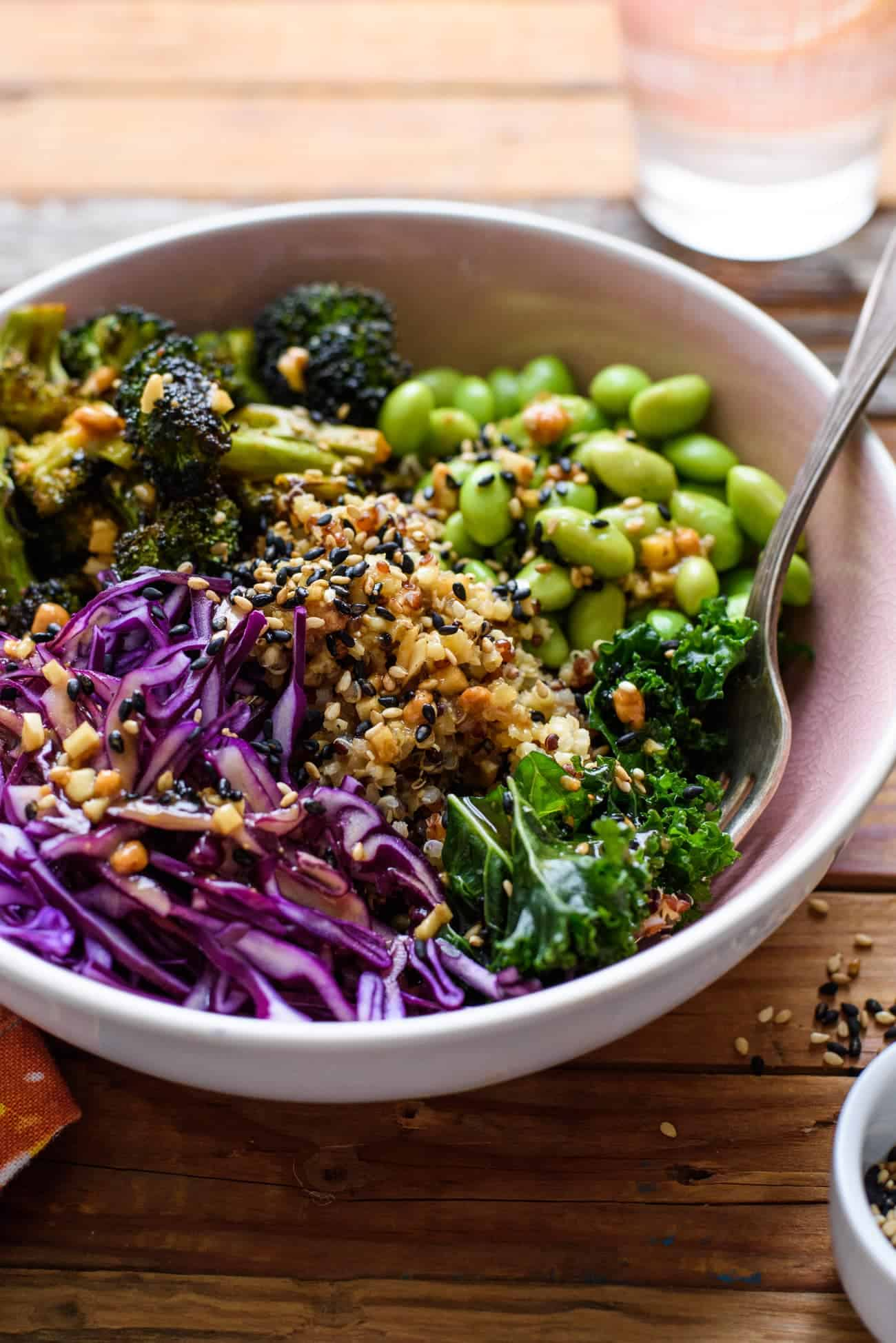 Close-up of vegan Asian-style grain bowl with edamame and purple cabbage