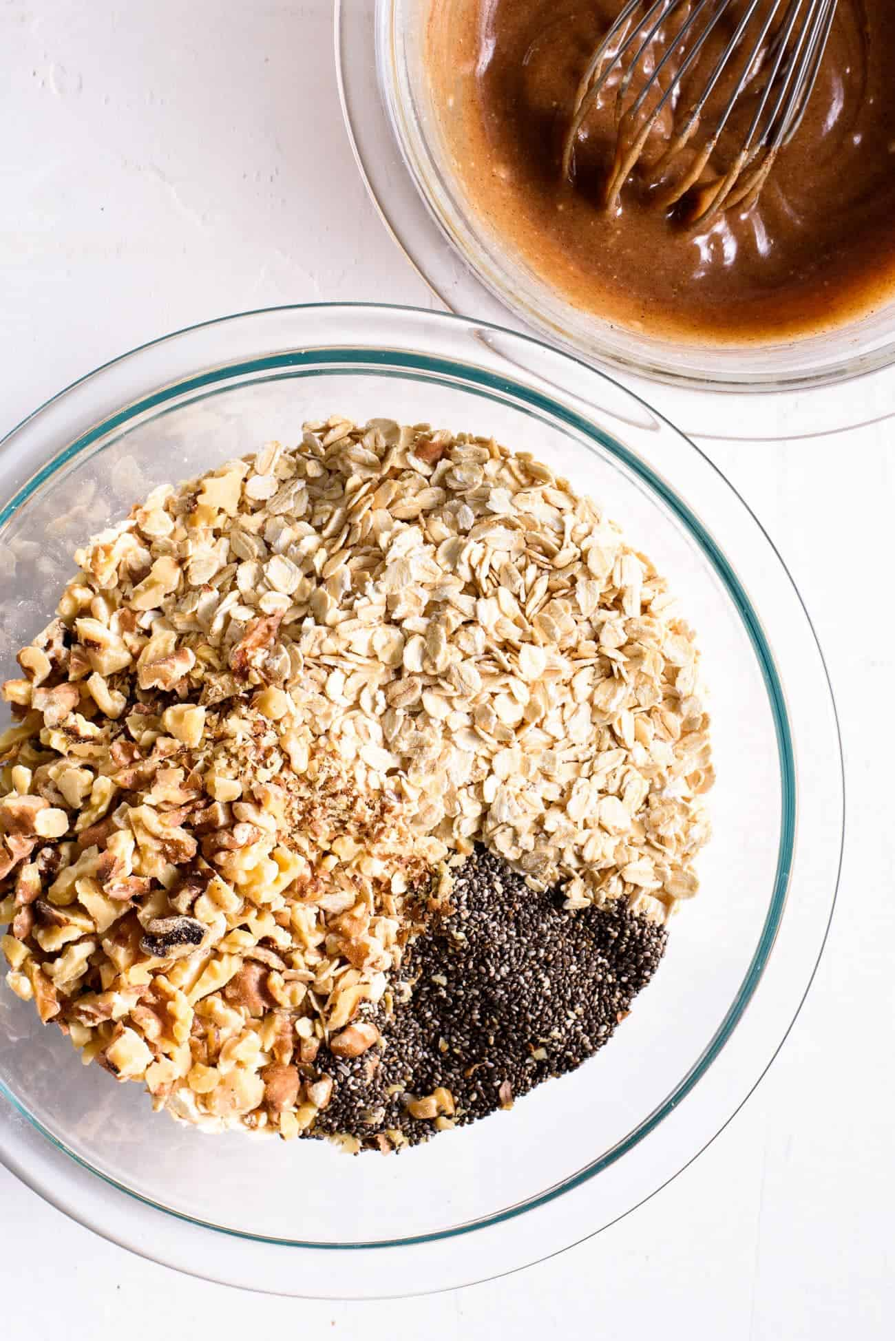 Ingredients to make tahini granola in glass Pyrex bowls