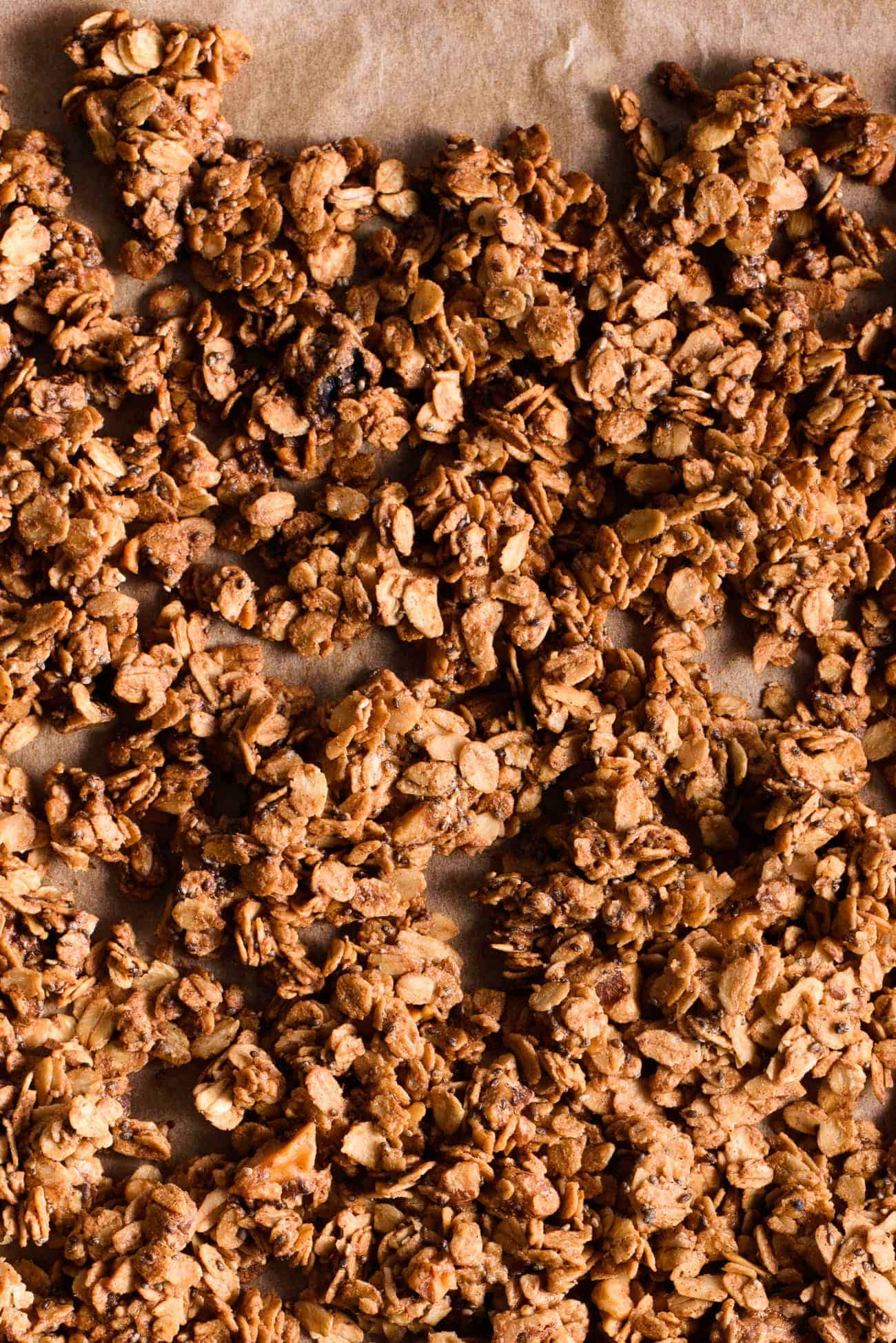 Freshly baked tahini granola on parchment paper