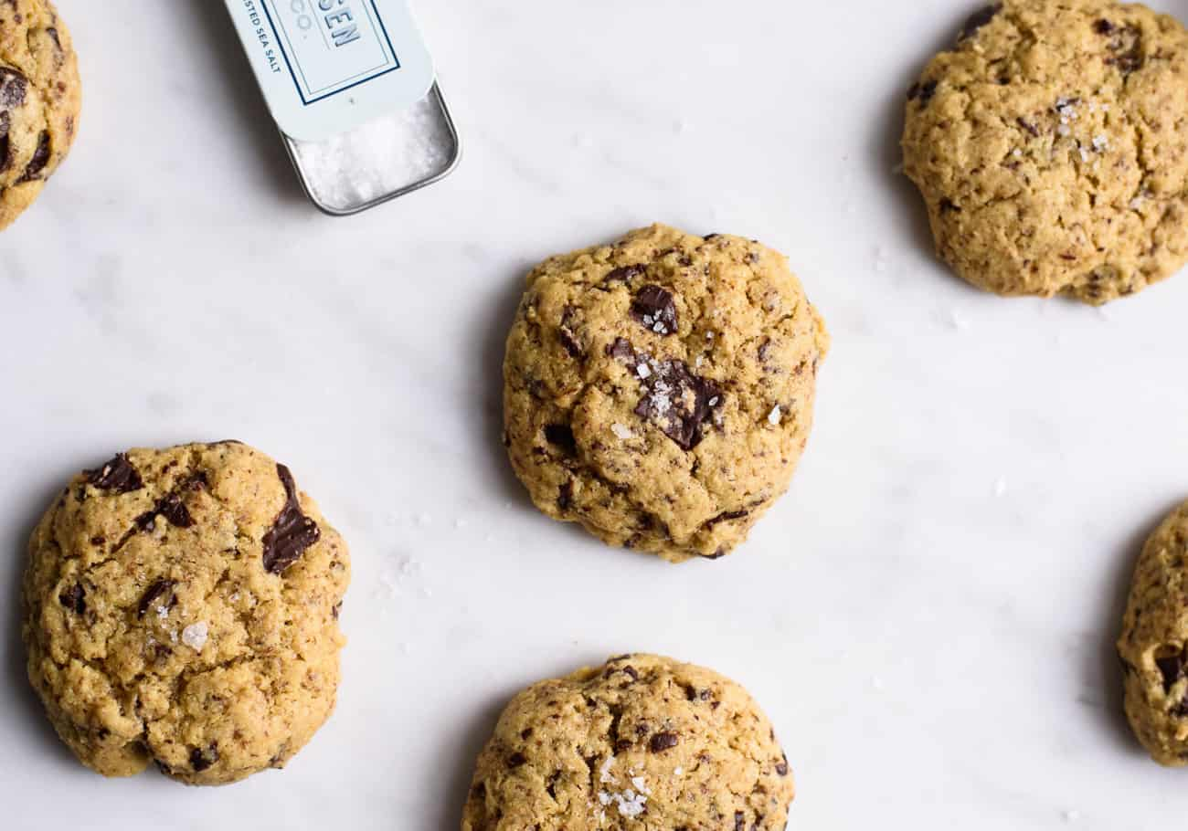 Chickpea Chocolate Chip Cookies on a marble board with sea salt