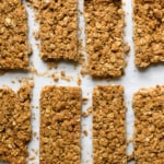 Crunchy peanut butter granola bars on parchment paper