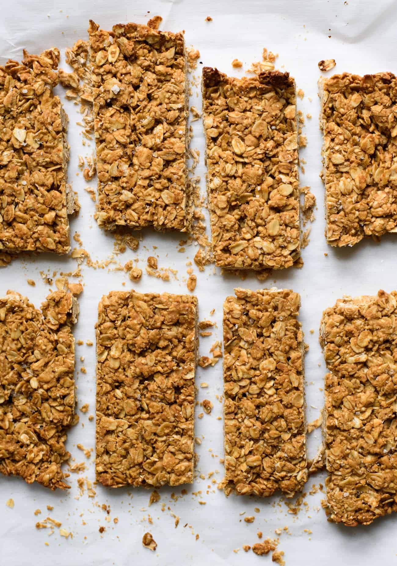 Baked crunchy peanut butter granola bars on parchment paper