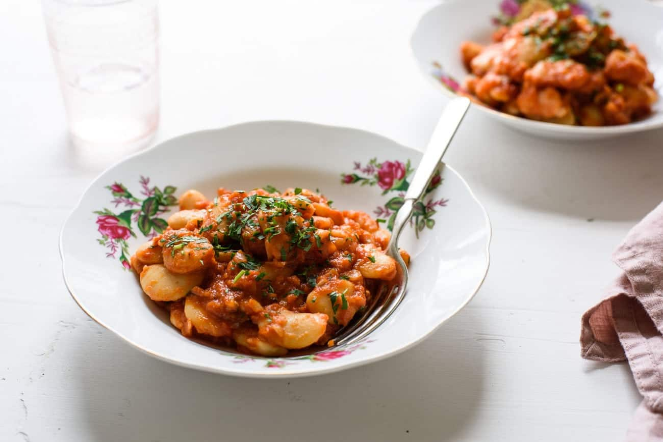 Two bowls of tomato braised beans