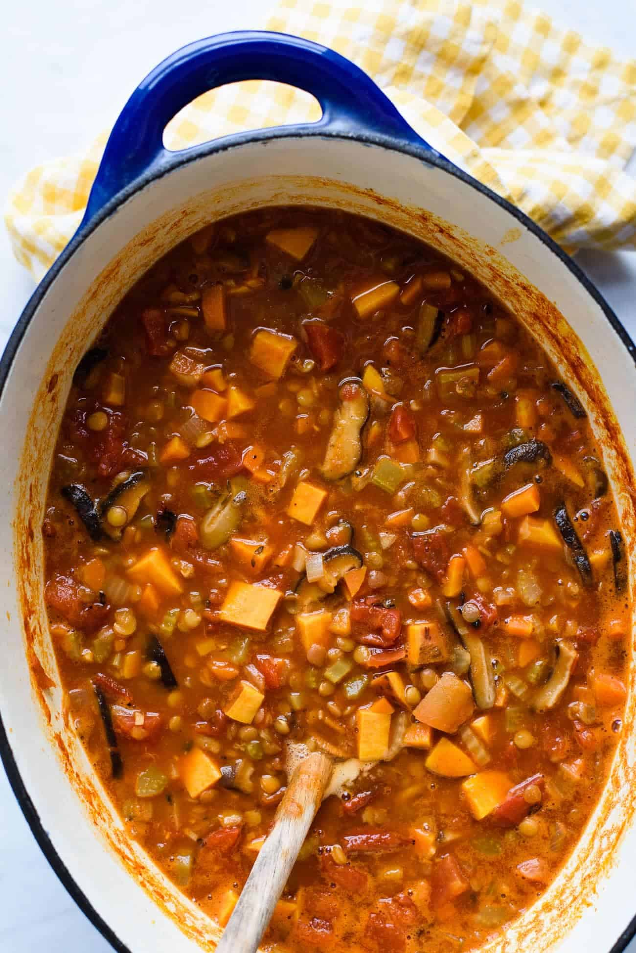 Easy lentil soup | Tomato lentil soup with sweet potatoes and shiitakes in a blue Dutch oven