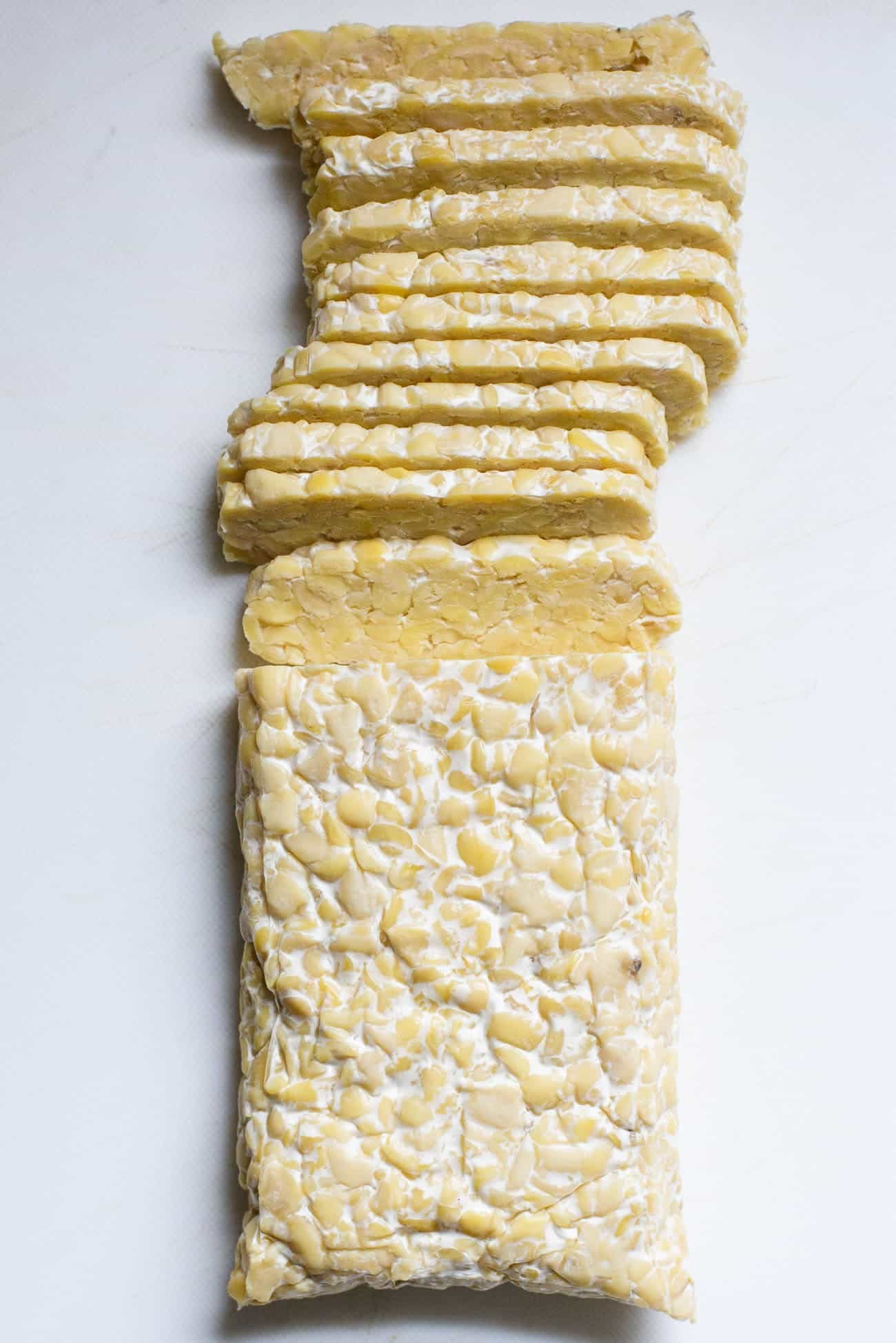 A block of tempeh cut into slices