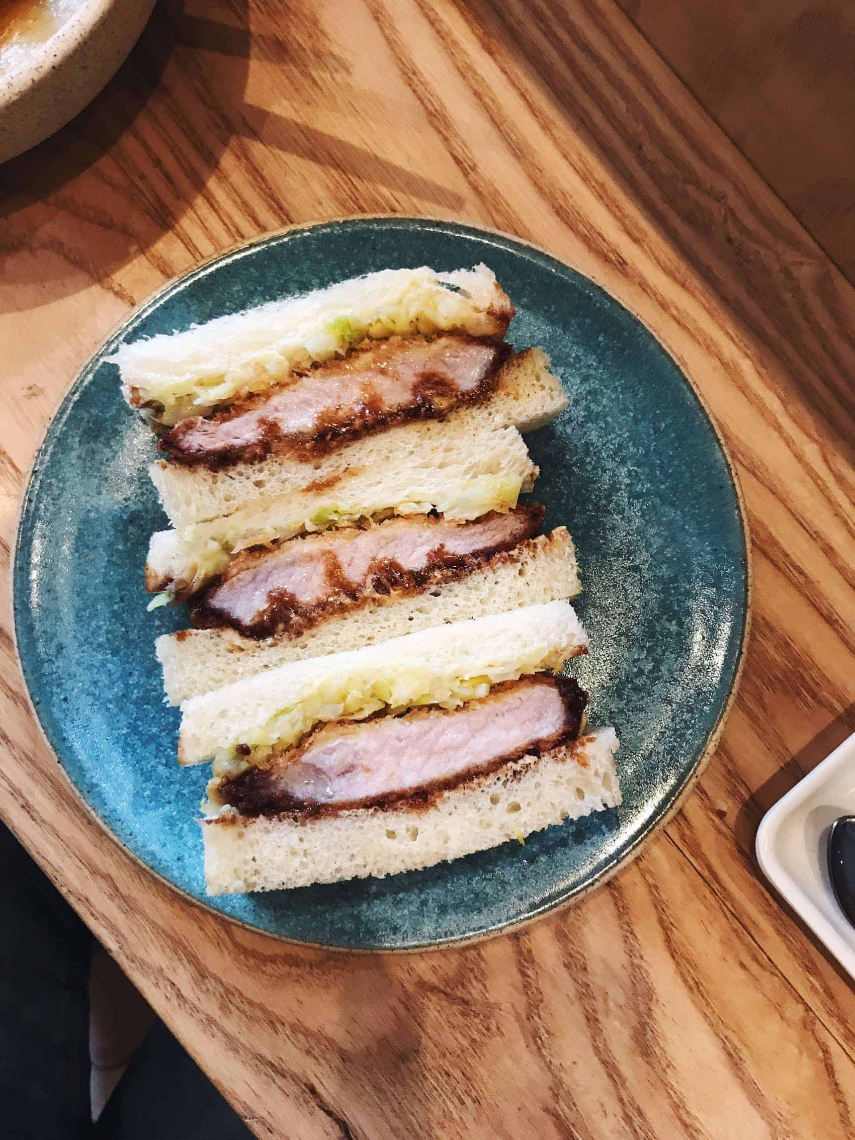 Pork Katsu Sando on a blue earthenware plate | Konbi restaurant in Los Angeles