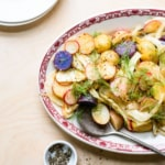 Potato salad without mayo recipe with fennel and radishes on an oval platter