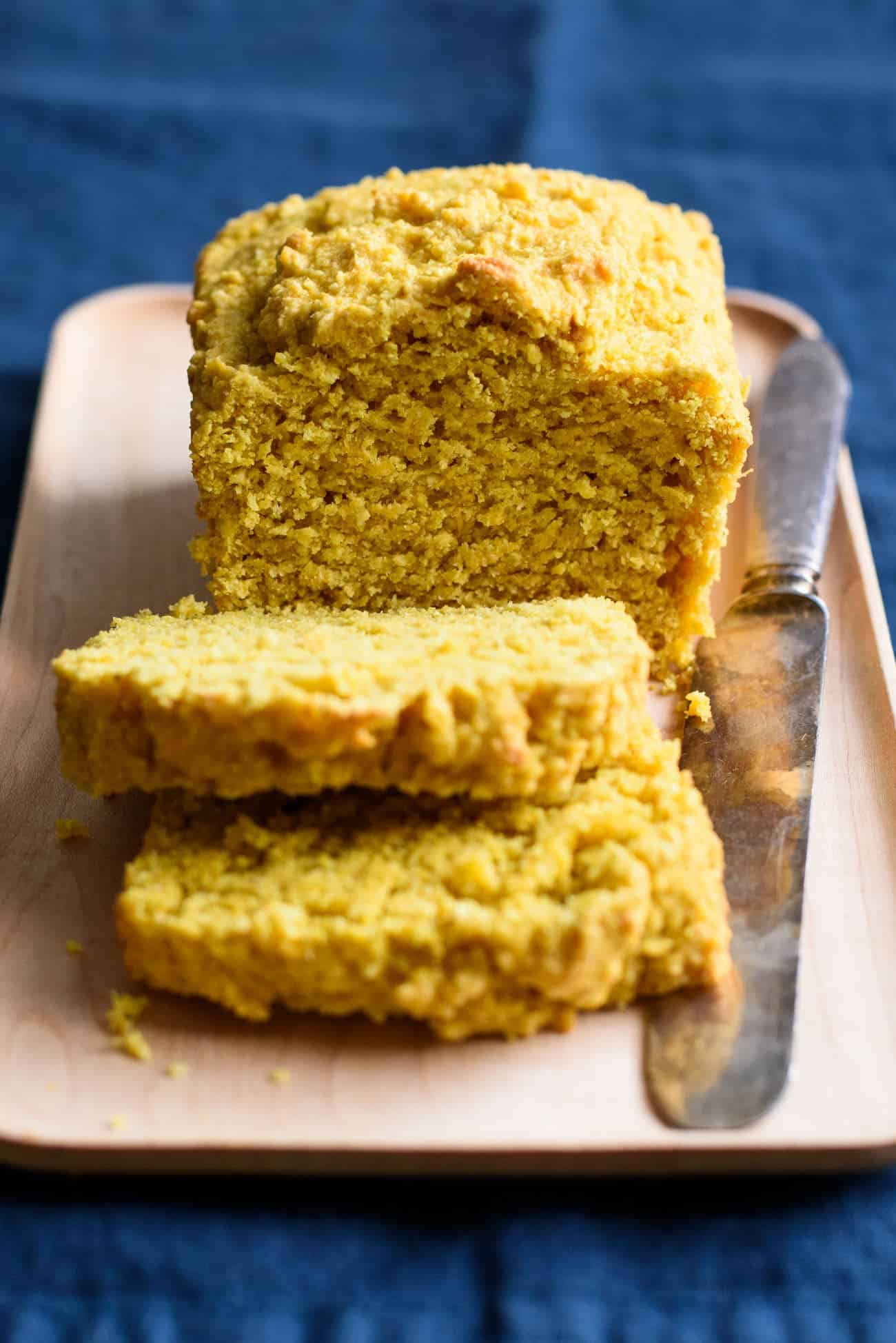 Close-up of a Turmeric Loaf Cake on a rectangular wooden plate