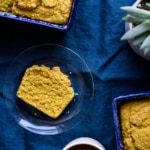 Turmeric loaf cake on a dark blue tablecloth