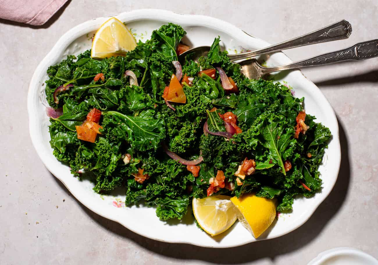 Sautéed lemon garlic kale on an oval platter.