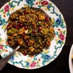 Farro salad with pesto and sweet potatoes on a vintage floral plate