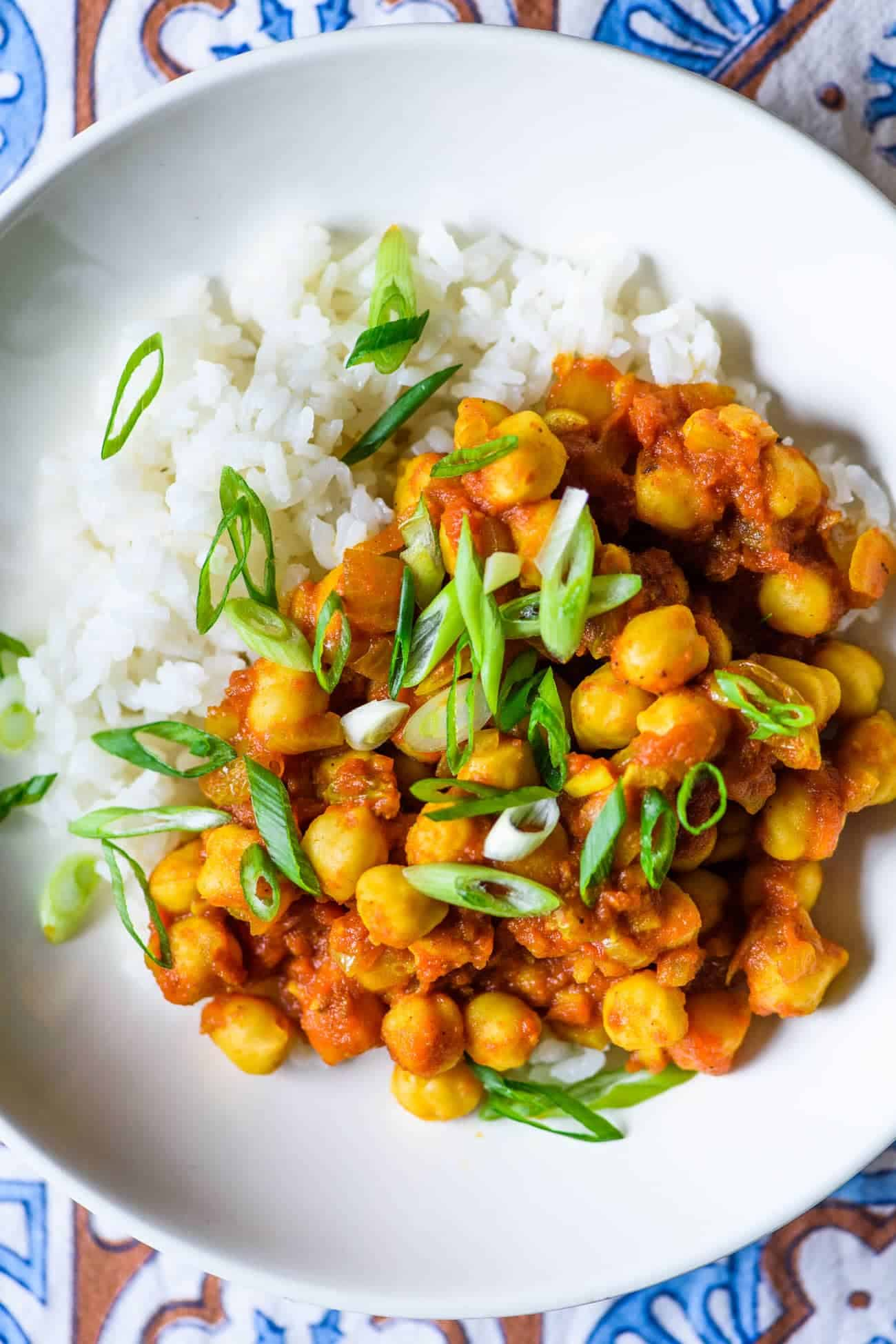 Simple Chana Masala recipe - Indian-spiced stewed chickpeas in a bowl with rice