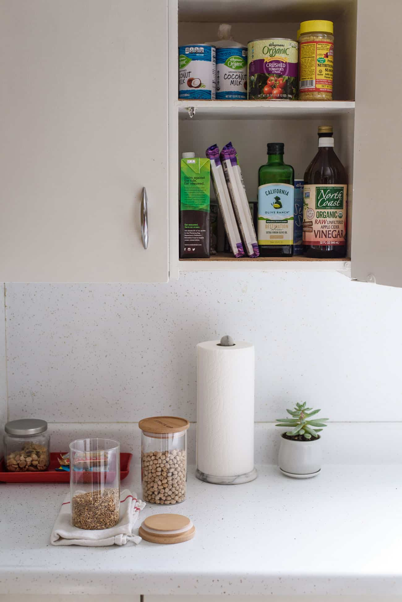 Kitchen counter with open cupboard door | Tips to purge your pantry
