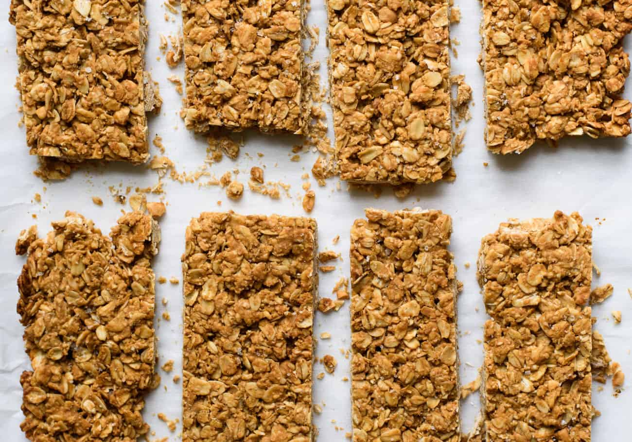 Homemade crunchy peanut butter granola bars on parchment paper