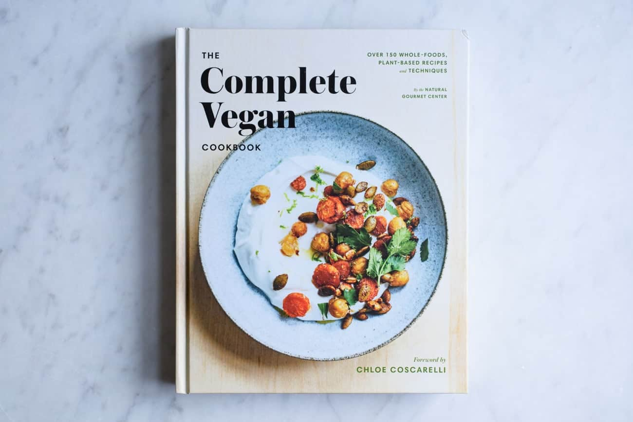 The Complete Vegan Cookbook on a marble table