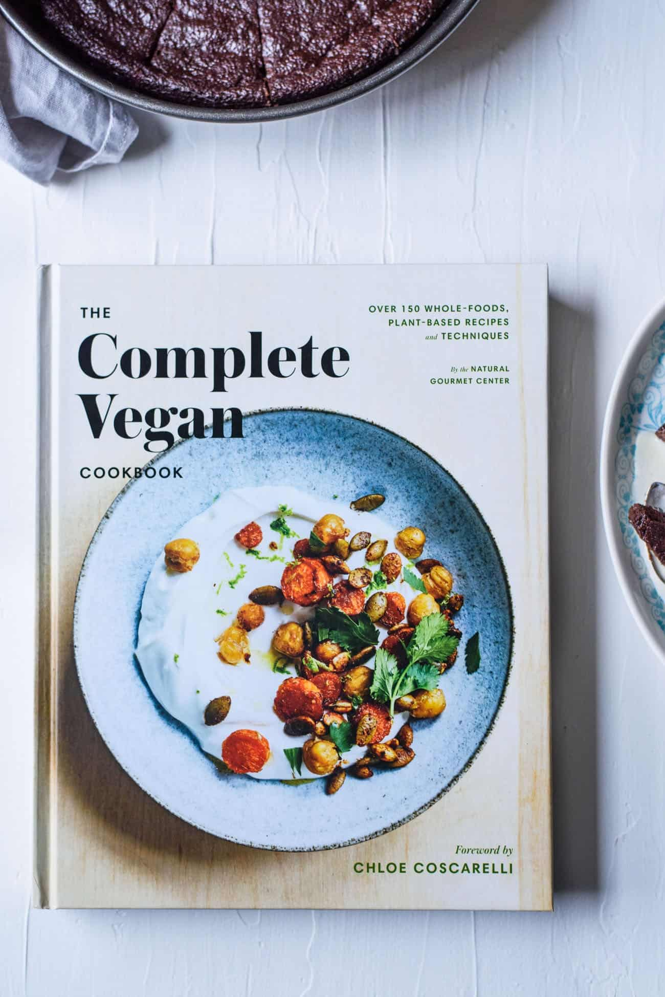The Complete Vegan Cookbook on a white table