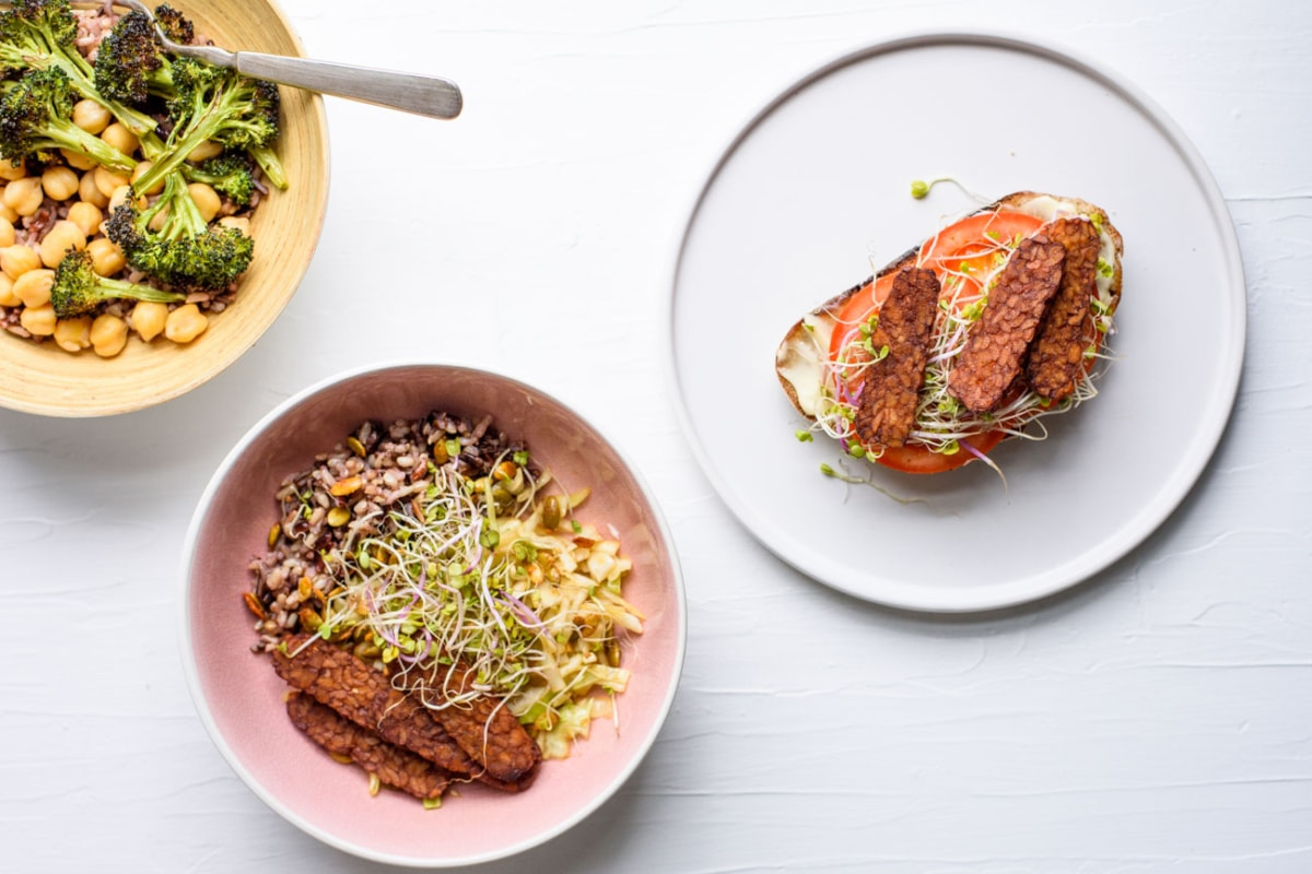 2 bowls of vegan meals and sourdough toast on a plate