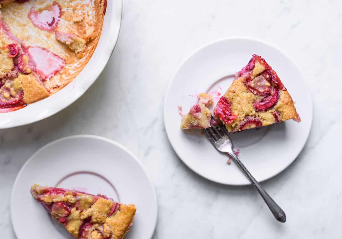 Strawberry clafoutis slices on white plates