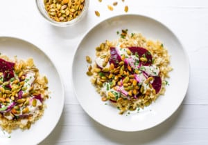 Crispy brown rice bowls with beets, spiced pepitas and tahini sauce