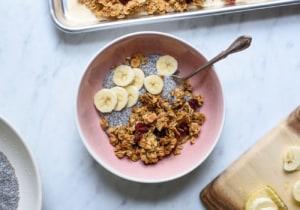Bowl with chia pudding, granola, and bananas