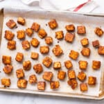 Easy baked tofu recipe - baked tofu cubes on a baking sheet