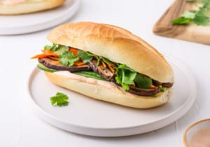 Vegetarian banh mi sandwich on a white plate