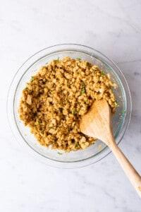 Golden brown baked tempeh meatballs on a baking sheet