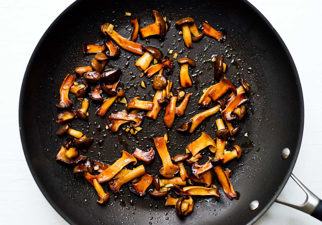 Glazed trumpet mushrooms in a skillet
