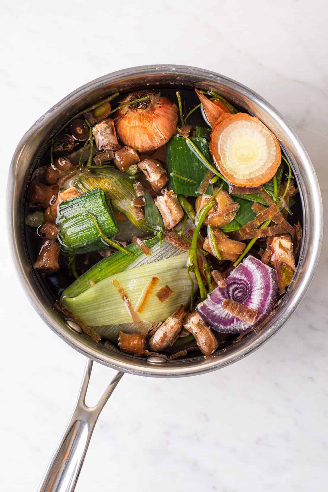 Vegetable scraps in a pot with water