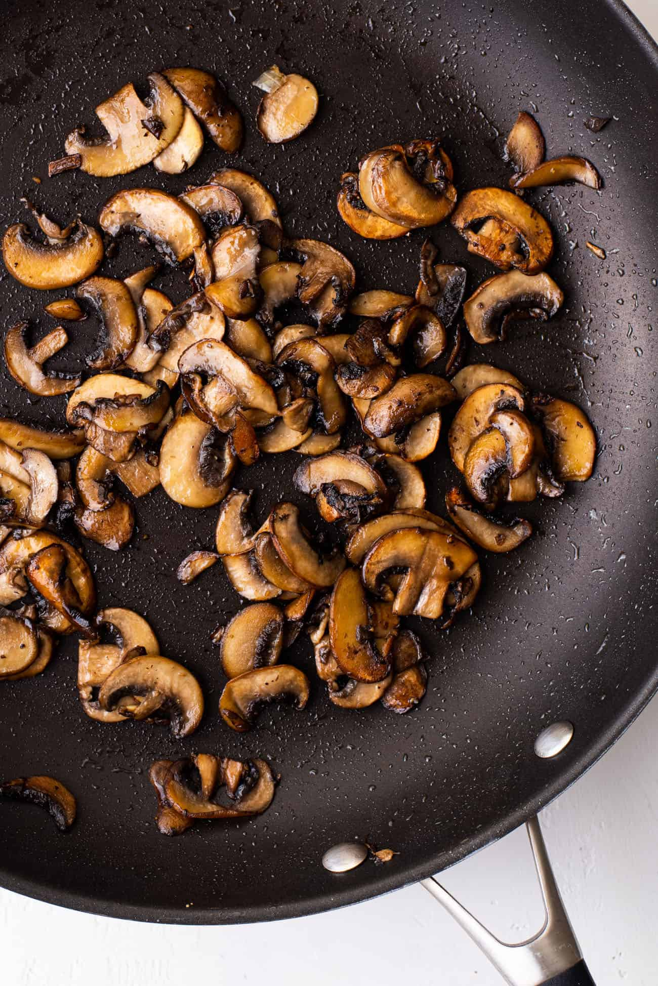 Sautéed cremini mushrooms in a skillet
