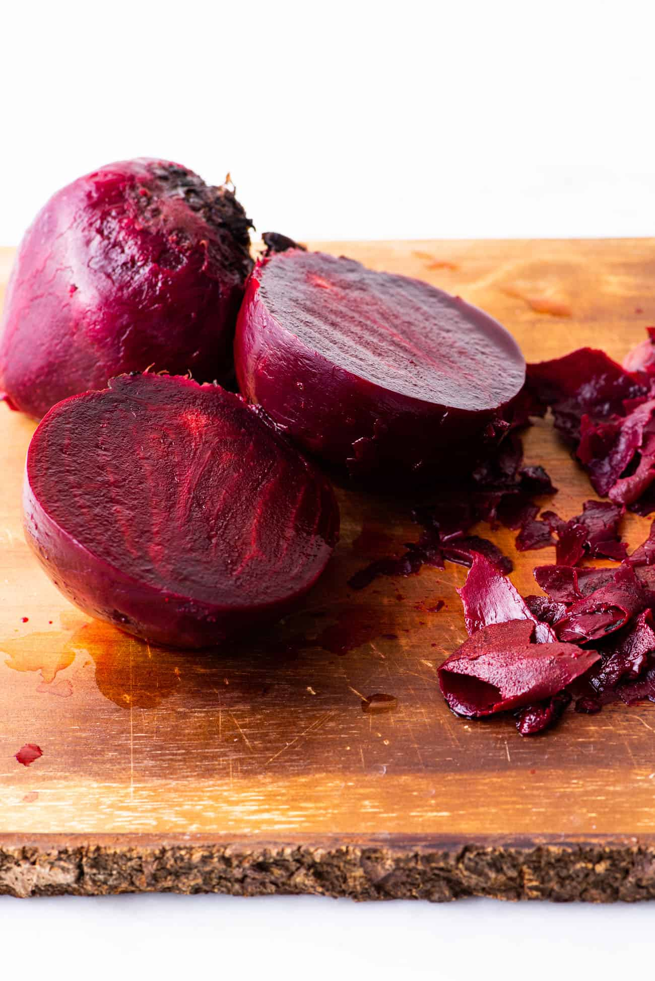 Peeled beets on a wooden cutting board