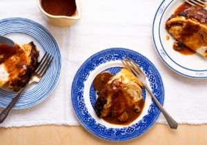3 vintage plates with wedges of whole roasted cabbage with tomato-mushroom gravy