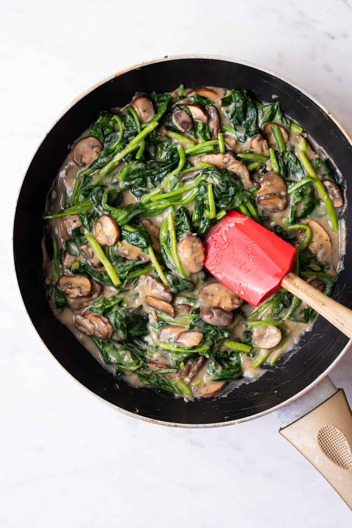 Vegan creamy spinach with mushrooms.