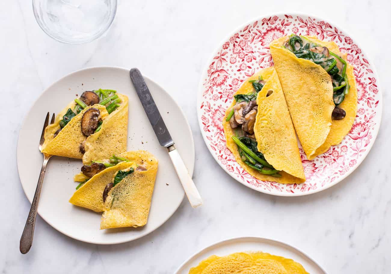 Savory chickpea crepes with creamy spinach and mushrooms.