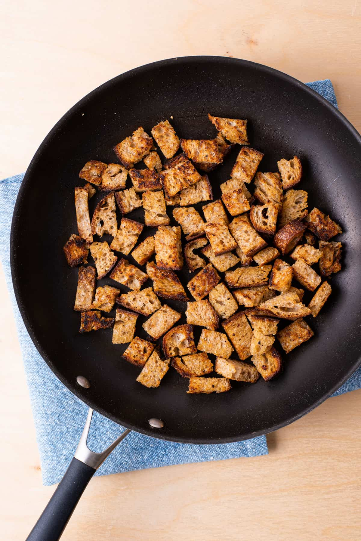 Garlic sourdough croutons in a skillet.
