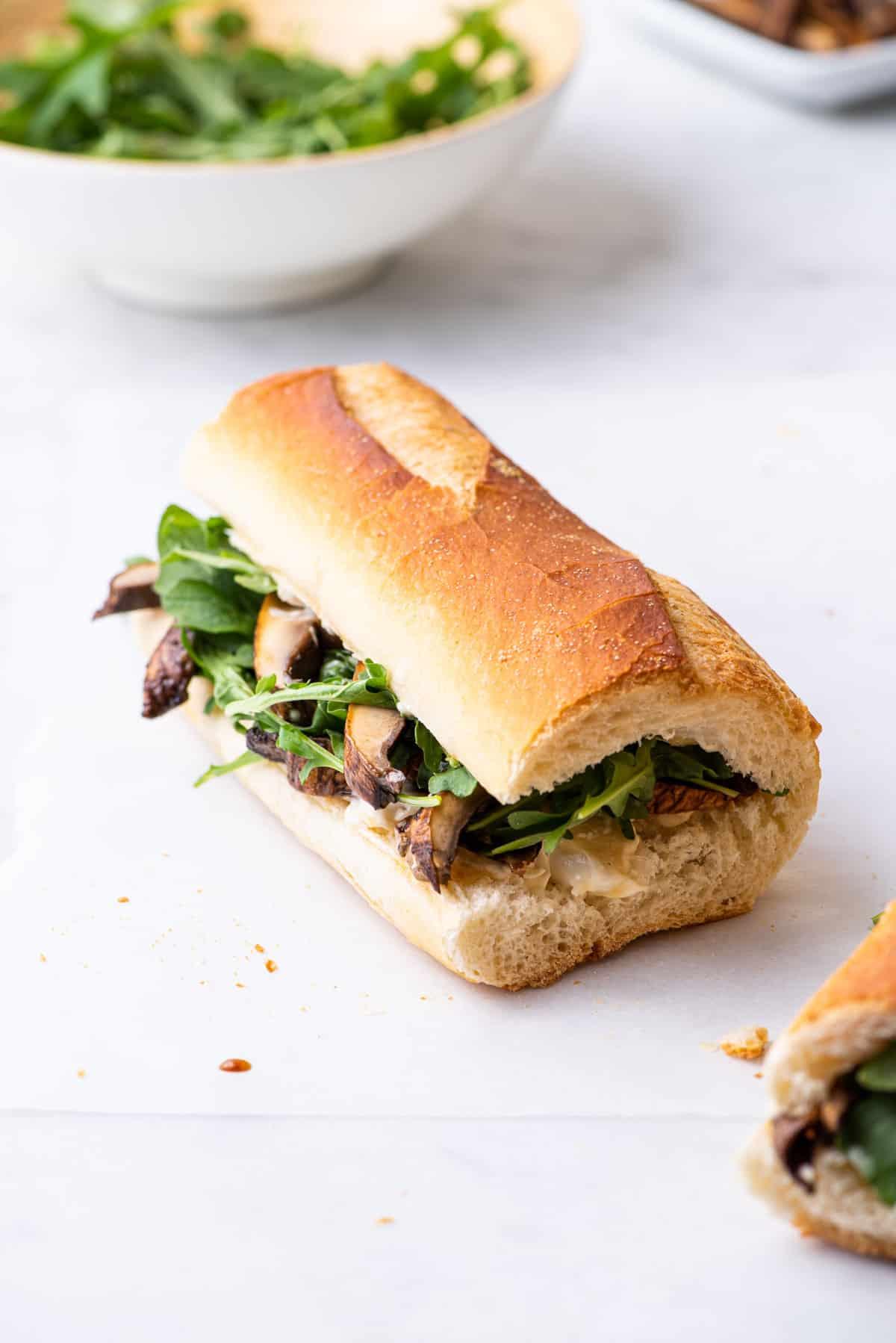 Vegan balsamic portobello sandwich on a baguette with arugula.
