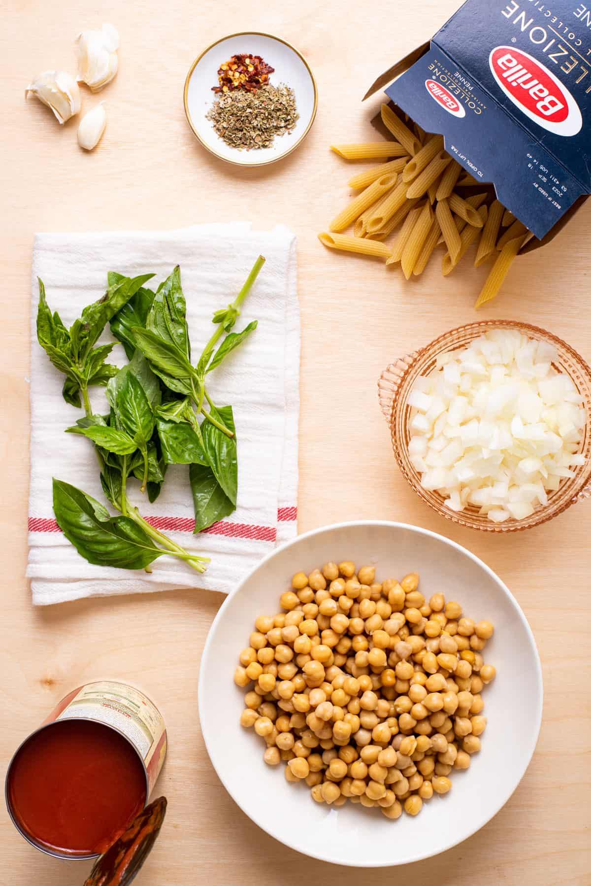 Ingredients gathered to make chickpea tomato pasta.