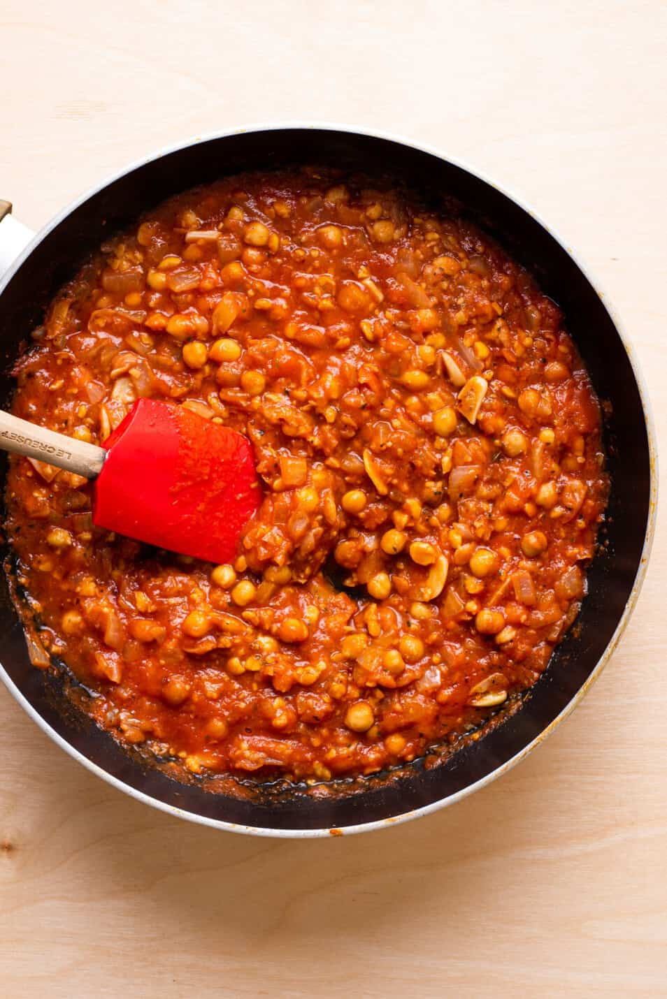 Chickpea tomato sauce in a skillet.