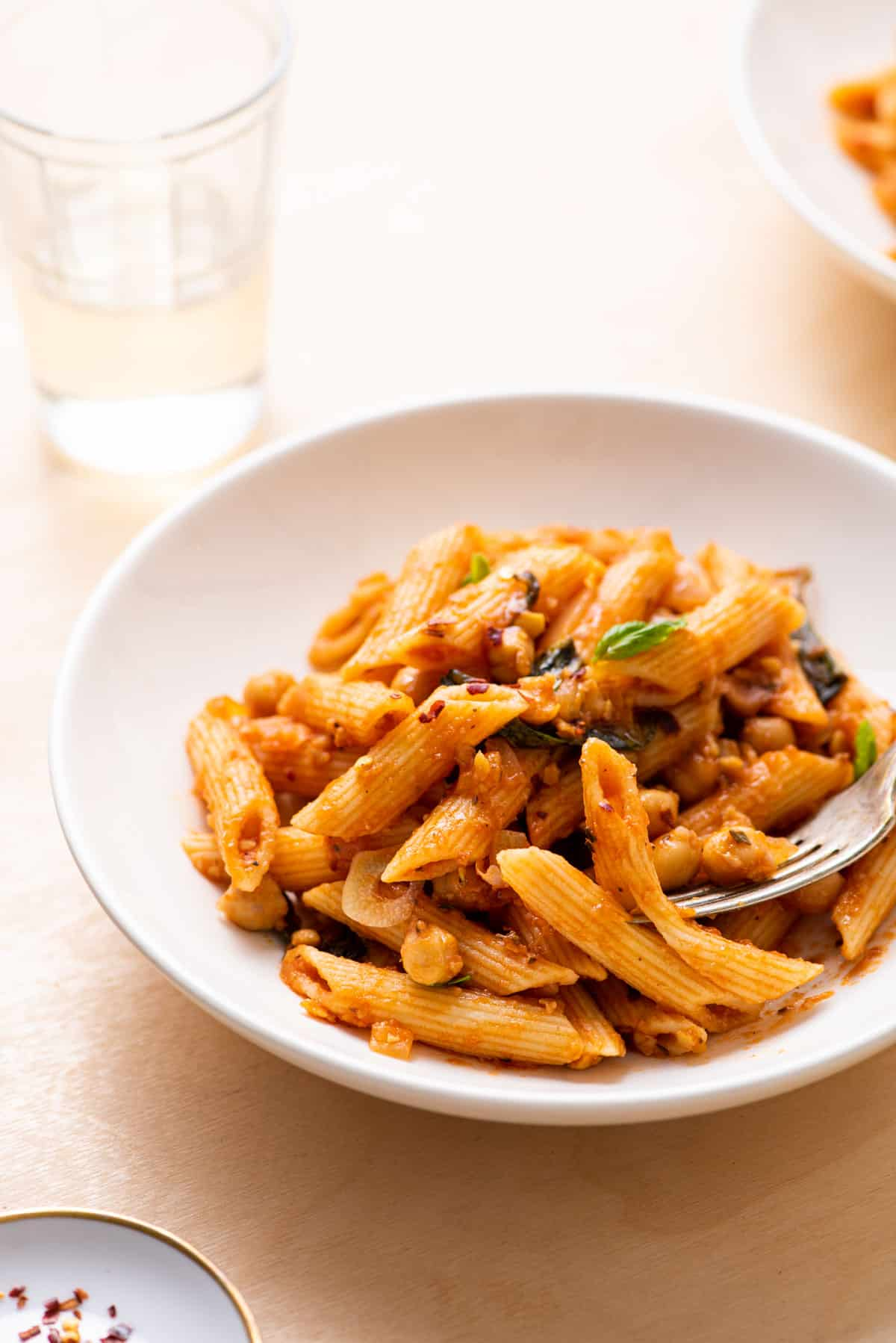 Penne with chickpea-tomato sauce with basil and chili flakes.