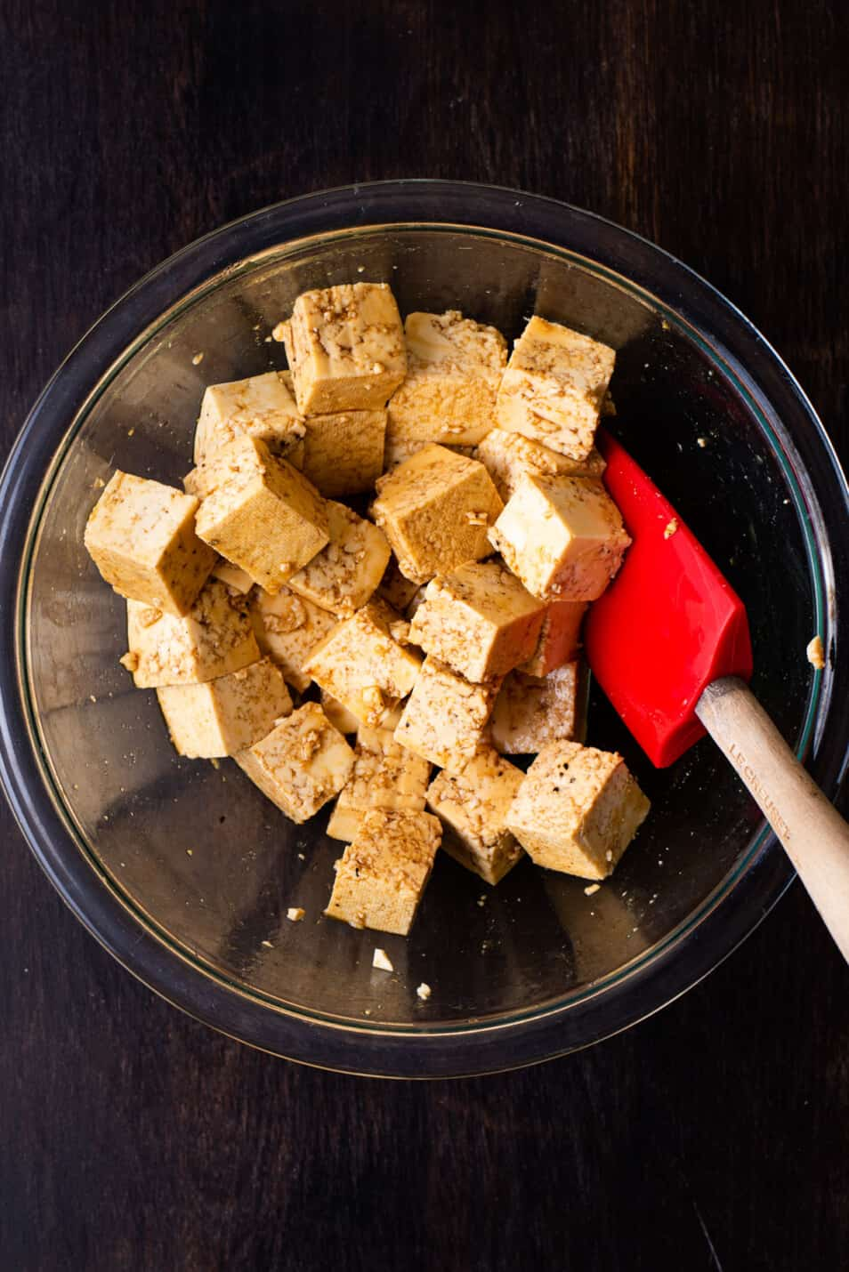Cubes of tofu marinating with soy sauce and maple syrup.