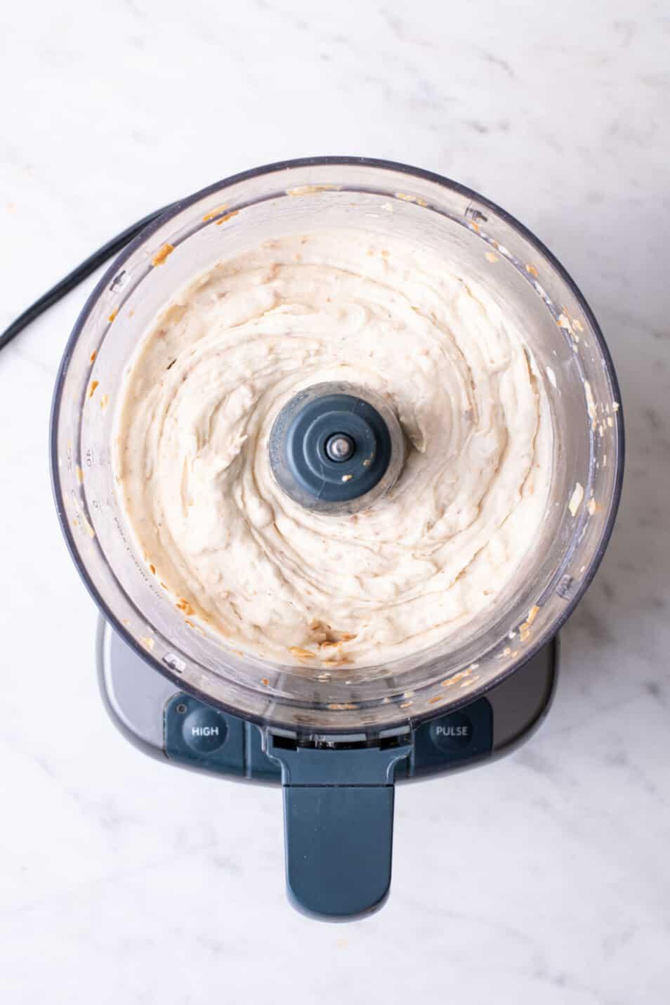 One-ingredient vegan banana ice cream in a food processor.