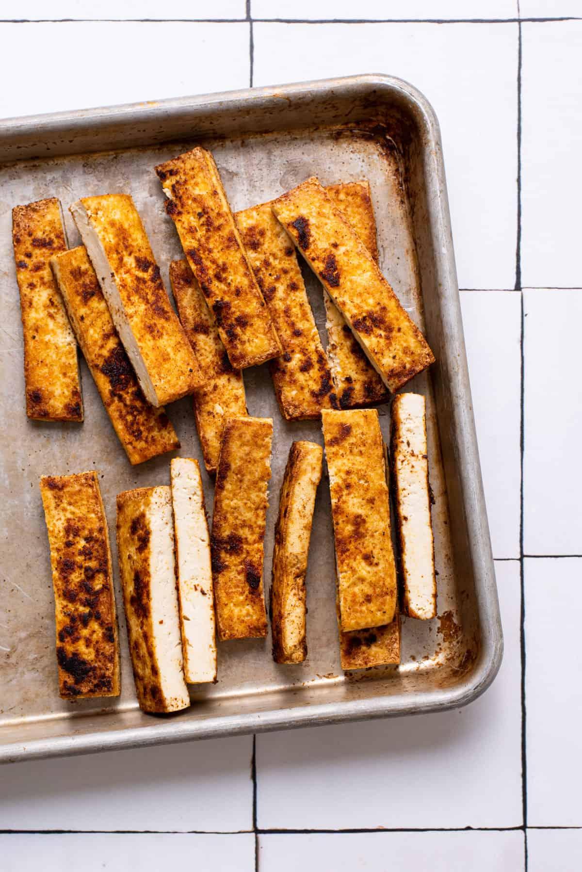 Seared spiced tofu, cut into batons.