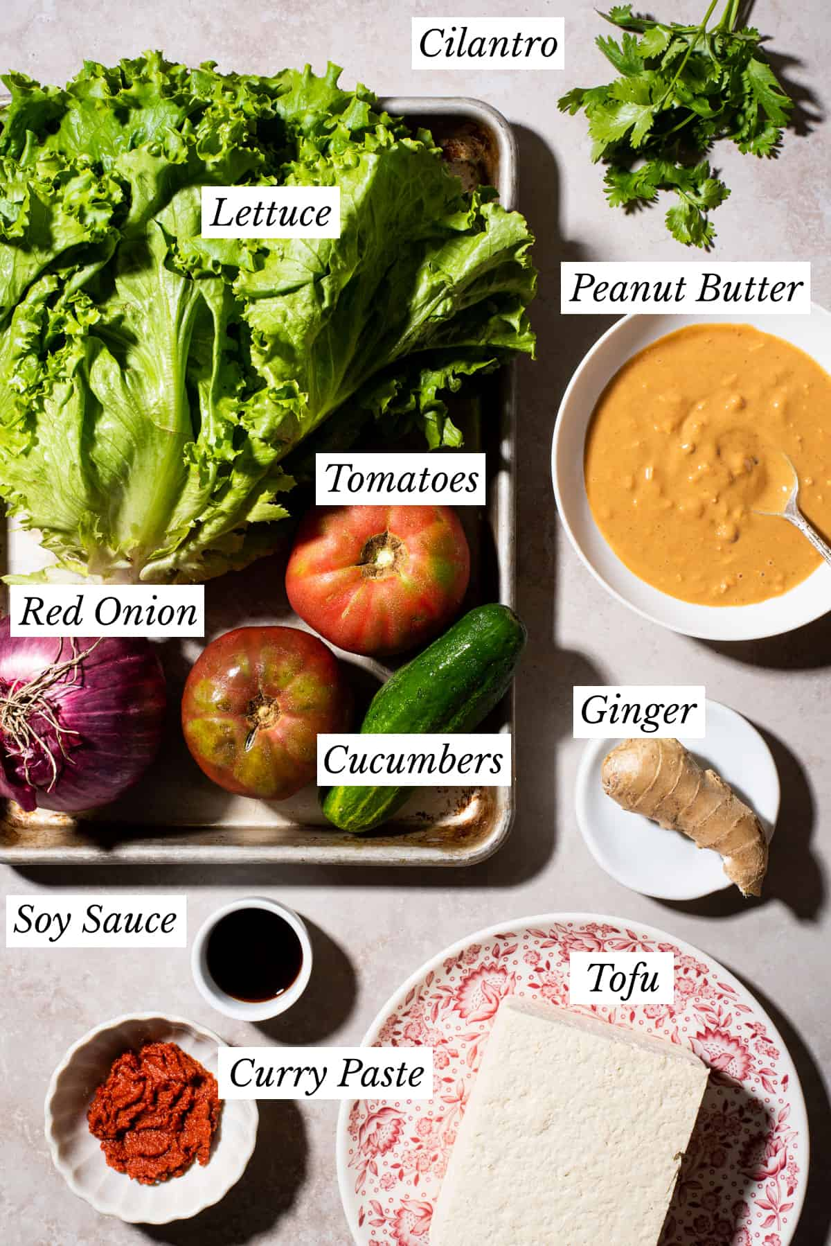 Ingredients gathered to make healthy thai salad with peanut sauce.